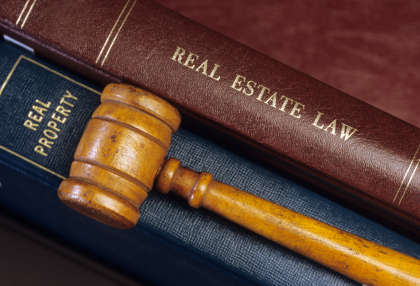 Real Estate Law Books and Gavel